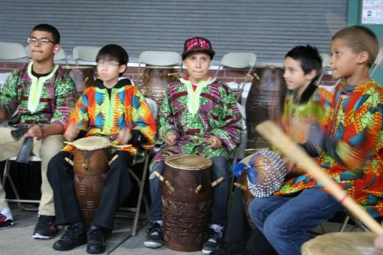 Playing totodzi drum from Ghana