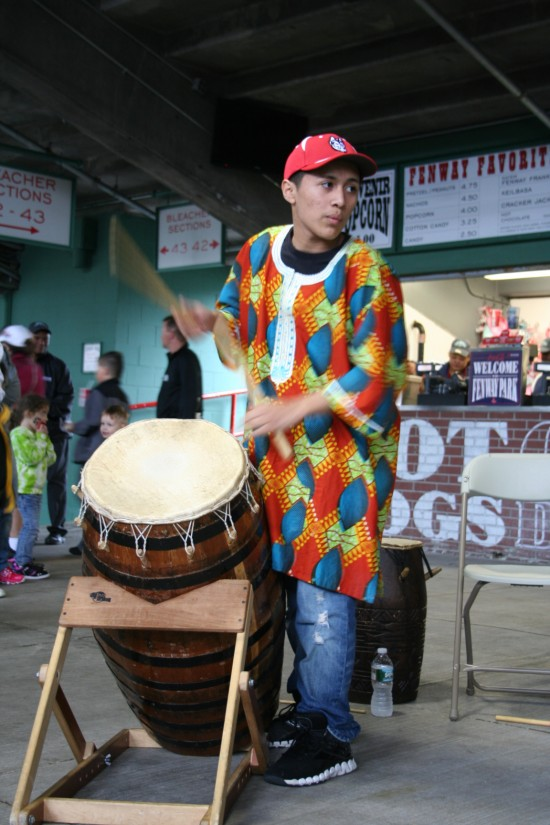 Student playing boba African drum